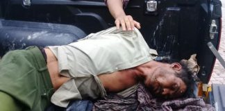 Tersangka PS(40) saat di giring ke Mako Polres Samosir Sumatera Utara