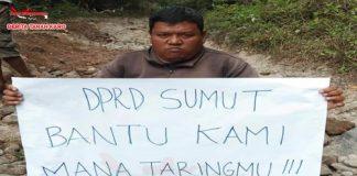 Salah satu warga yang menuntut DPRD SUMUT melalui sebuah tulisan