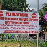 Pemasangan Spanduk Peringatan di salah titik jalur pendakian ke Gunung Soputan di Desa Pinabetengan Utara